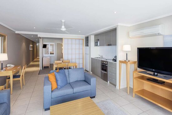 Interior view of lounge, dining area and kitchen in Two Bedroom Pool View Suite