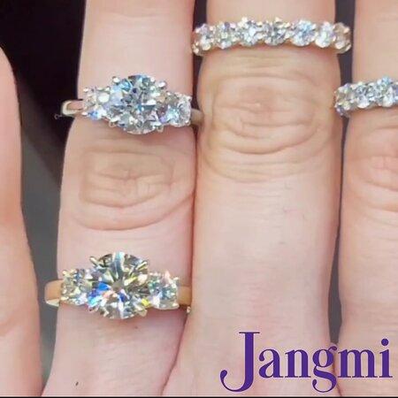 Round brilliant cut diamonds on our custom three stone settings