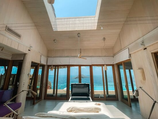 Main suite in our Chapter 2 villa with the retractable roof open