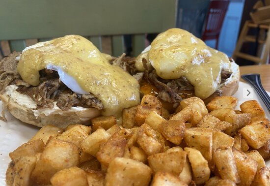 Cochon Benedict with breakfast potatoes and jalapeños
