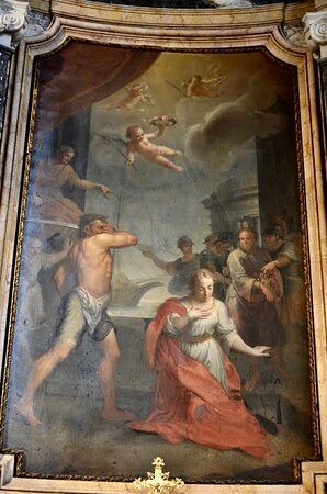 The altarpiece depicts The Martyrdom of St Justina.The chapel is enclosed by a polychrome marble balustrade and wrought iron railings, on an ogee curve plan. Outside these, to the left, is the fine Baroque monument to Alessandro Borgia 1767 by Tommaso Righi in the style of Bernini.