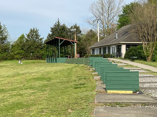 Artificial turf tees and our clubhouse.