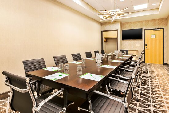 The Executive Boardroom comfortably seats up to 14 guests.