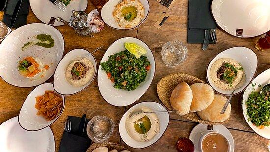 Multiple starters (tabbouleh, hummuses, labneh)