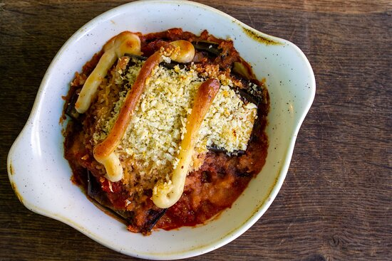 Berenjena Parmigiana (vg) Layers of aubergine in a rich tomato sauce with olives and lemon crumb (Soy, Gluten, So2)