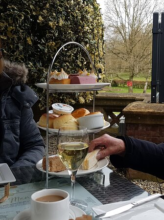 Superb selection of cakes, scones and sandwiches (and of course a glass of wine!)