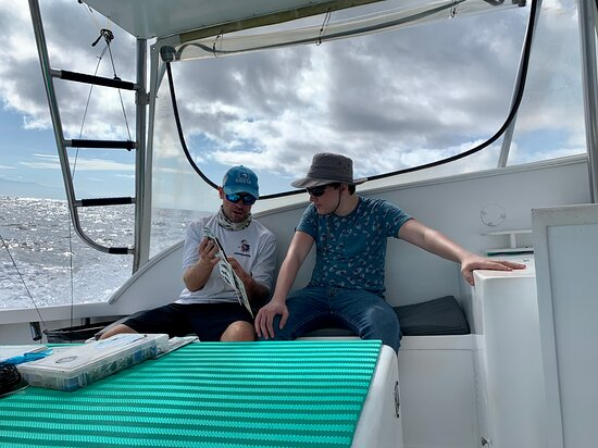 Ben showing Aaron how to rig the line.