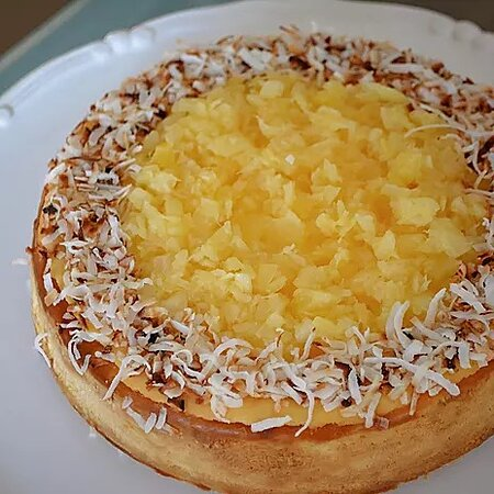 Piña Colada Cheesecake: A velvety Pina Colada flavoured cheesecake with a coconut shortbread crust, finished with pineapple and toasted coconut.