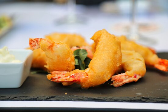 Caribbean prawns in a coconut breadcrumb with mango, pineapple and coriander salsa