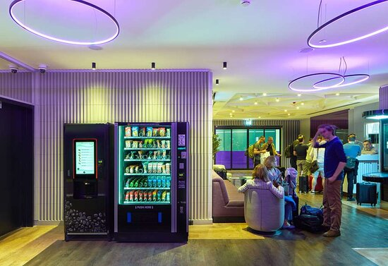 Guests and Vending Machine in lobby