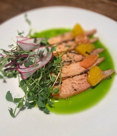 Salmon crudo with Orange segments & pea tendrils salad.