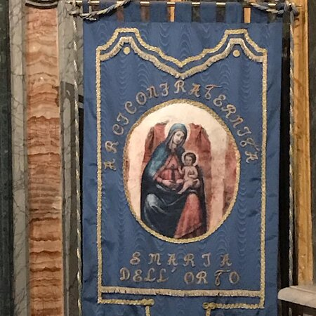 Right hand aisle. The processional banner of the Archconfraternity of St Maria dell'Orto.