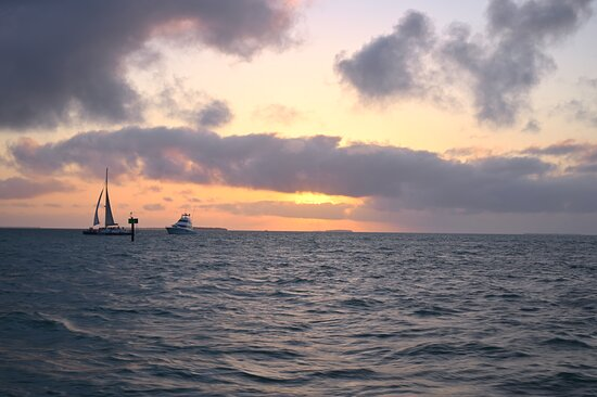Sunset Sail in Key West with Beverages Included: Other boats enjoying the sunset. A little cloudy but still pretty!