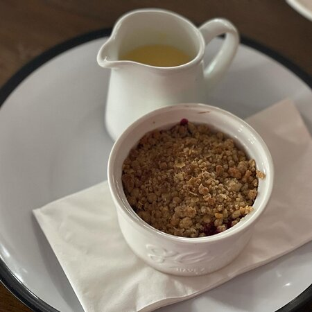 Pear & Berry Crumble served with custard. Made from scratches in our kitchen.