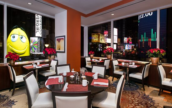 Brasserie 1605 overlooking Times Square and TKTS Red Steps