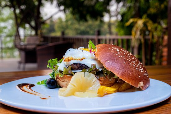 OPEN BURGER (PARADISO SPECIAL) - Made By Beef Meat Seasoning Salt,Peper,Mix Herbs We Serve With Chips,Pineapple Slice & B.B.Q Sauce.