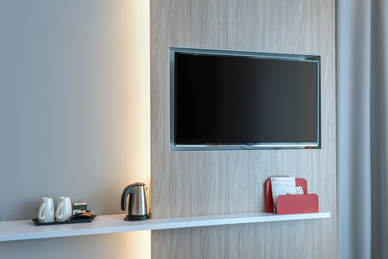 A thoughtfully designed Next Generation bedroom with a smart TV.