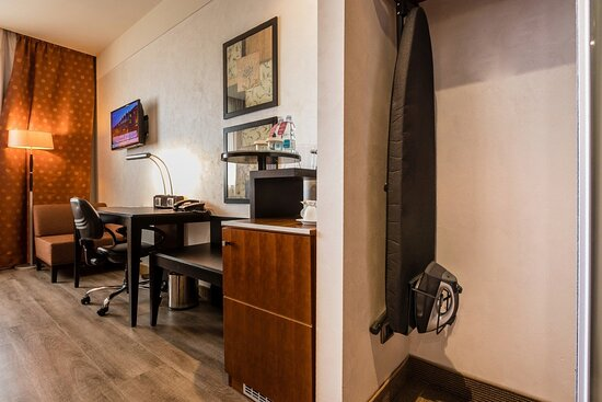 Complimentary iron and iron board in each room