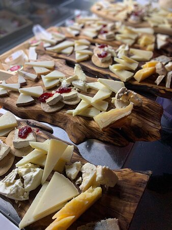 very nice variety of spanish cheeses in flor de sal wine bar