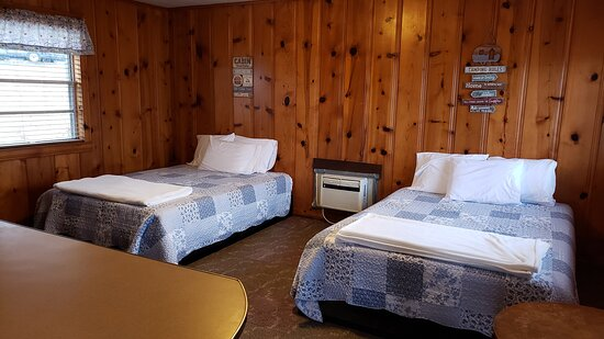 Bernice, OK: We have three cabins with two queen beds. Each has their own kitchenette.