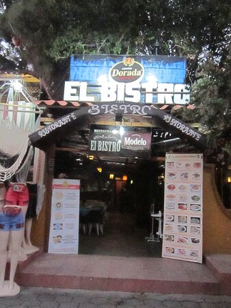Solola, Guatemala: outside the restaurant showing the picture menu and covid-19 sign