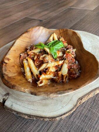 Azaiba, Oman: (Rib Pasta) Marinara sauce on penne topped with grilled ribs.