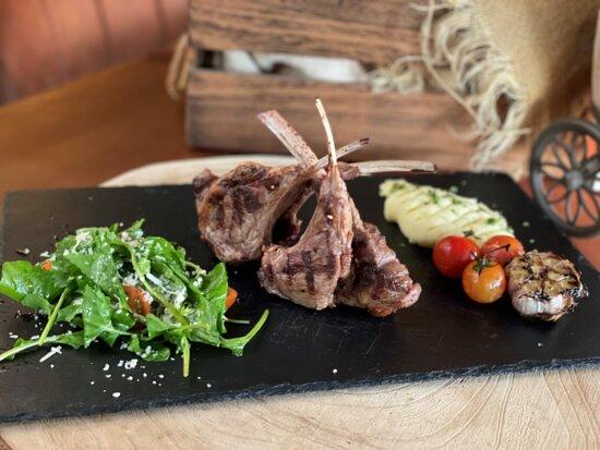 Azaiba, Oman: (Lamb Rack) Rack of lamb served with parmesan and Rocca.