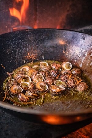Snails in the skillet, with local rosemary and vinegar