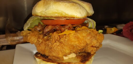 hand breaded with our secret seasoning topped with bacon, lettuce, tomato finished with house made Chipotle mayo  We call this this the BIG CRUNCH