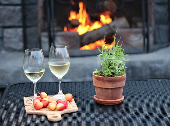Wine by the outdoor fireplace