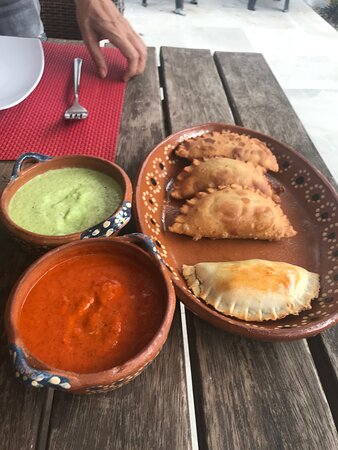 Argentinian meat empenadas with Tomatillo/Habanero (green) salsa, and Roasted Pepper/Guajillo (red) salsas.