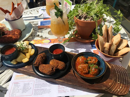 Tapas Board, and Buttermilk chicken and sweet potato fries to the left.