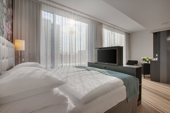 An Executive room with a comfortable sitting area and city views.