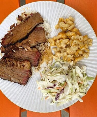 Sliced Brisket Plate Lunch.  Served over rice and gravy with your choice of two sides.