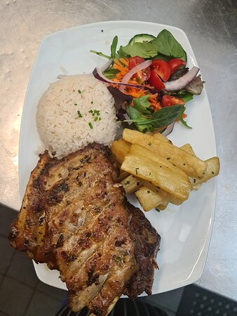 Pork Ribs with a rice, cassava and salad