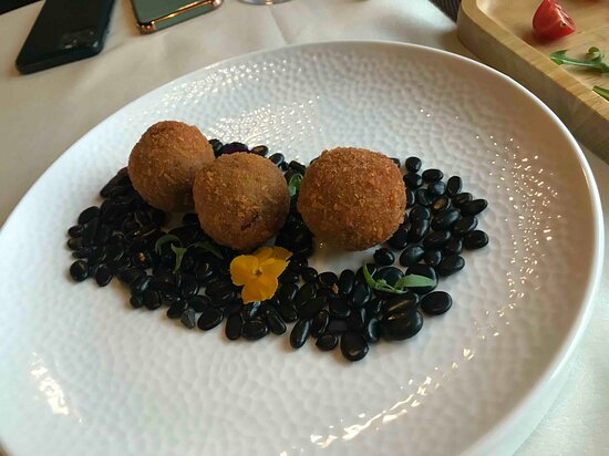 new appetizer! Fried  rice balls with cheese, olive paste and some 'secret  ingredients' inside