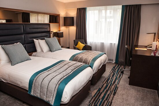 Twin hotel room with two beds