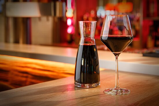 Wines by the glass or carafe, served up at the inviting bar.