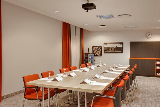 A neat, comfortable meeting room, offering high-tech facilities.