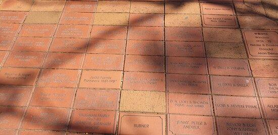 Dublin War Memorial paving around the memorial bearing community members name who supported the memorial