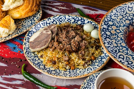 Traditional Uzbekistan Pilav from Afsona with traditionally the best addition - Achikchuk salad!
