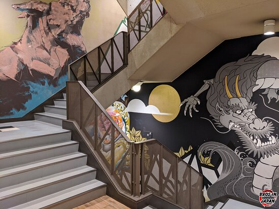 There is an escalator you could use to move between floors, but we'd recommend taking the stairs as each floor showcases amazing wall art.