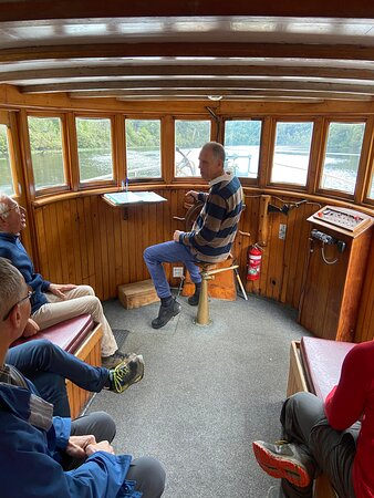 Captain sailing the Acadia II on the Pieman River