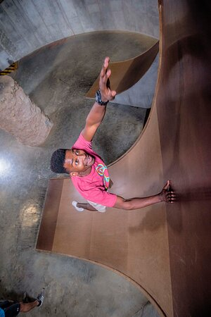 Reaching for the top of a warped wall