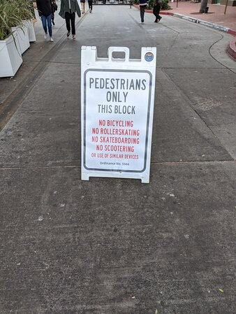 Pedestrians only sign outside O'Malley's bar.
