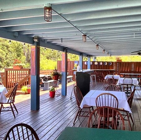 Outdoor covered deck dining area