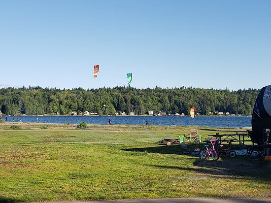Kite boarders taking advantage of the windy conditions.  Picture taken from the edge of  site T33/ t32 in the foreground