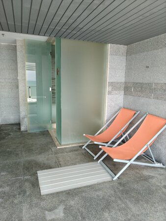 Steam Room and sunchairs on the balcony