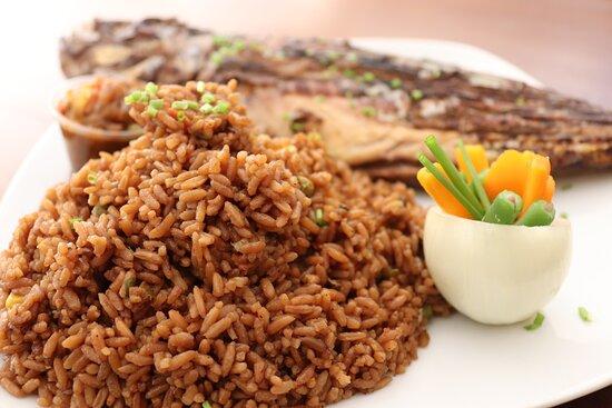 Kenema, Sierra Leone: The best selling dish. Charcoal grilled fish.