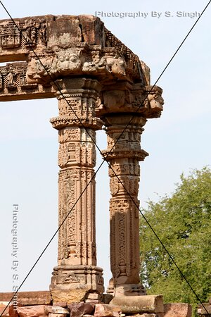 Detail of Carving , Sculptures on upper horizontal beams & Pillars , Hindola Torana, Gyaraspur, Vidisha, Madhya Pradesh ,India. Chaukhamba ( Four Pillars ) 9-10th century This monument, The Four Pillars, are within the Hindola Torana complex. This seems to be the mandapa of the temple, which entrance gate would have been Hindola Torana.